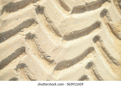 Wheel tracks on sandy background. Copy space texture