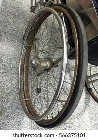 The wheel of wheelchair on the floor