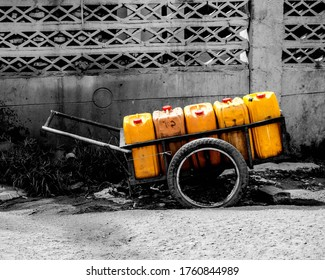 Wheelbarrow carrying water supplies. A modified wheelbarrow carrying water supplies to nearby homes in need.