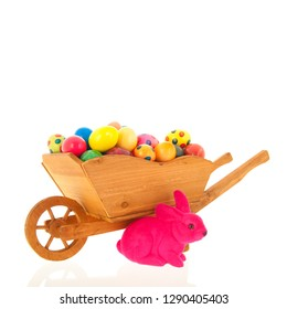 Wheelbarrow easter hare and eggs isolated over white background