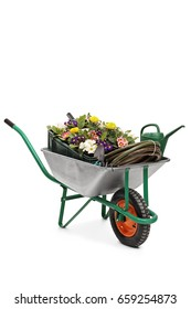 Wheelbarrow filled with flowers and gardening equipment isolated on white background