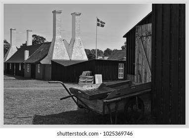 A wheelbarrow in front of an old smokehouse - Bornholm - Denmark