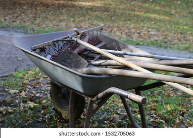 Wheelbarrow with garden tools for facility management, gardening in autumn