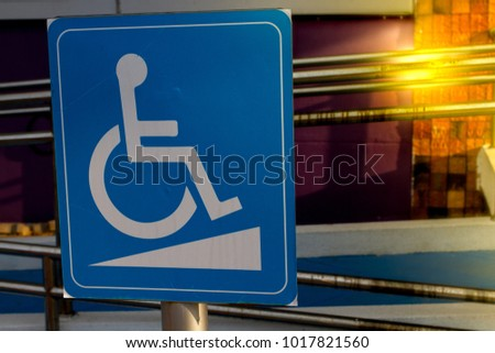 wheelchair accessible symbol white on blue stock photo edit now