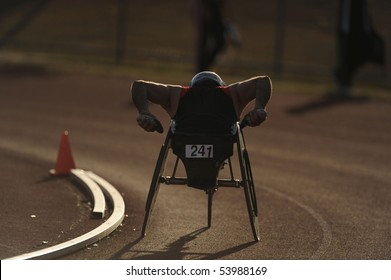 A wheelchair athlete racing during competition