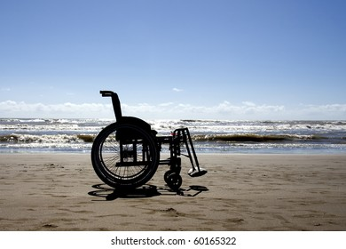 Wheelchair in the beach, backlight