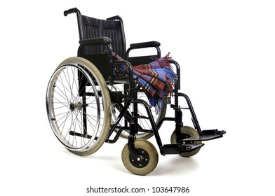 Wheelchair with blanket isolated in white background