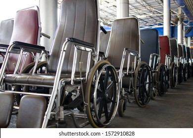 Wheelchair for elderly patients and disabled people with good quality and standards,Many of wheelchairs lined up and ready for use,services of hospital to help,care and facilitated medical treatment