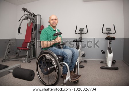 Wheelchair gym dumbbell his hands rehabilitation stock photo edit
