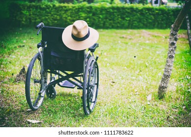 wheelchair with hat in park : healthy strong medical concept