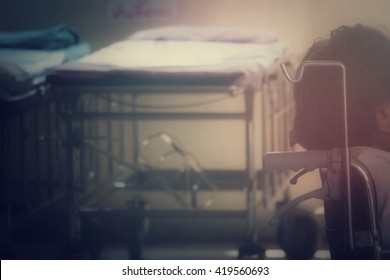Wheelchair and hospital bed in hospital, process vintage tone