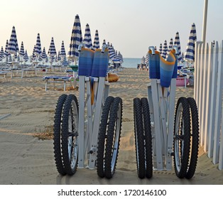 A wheelchair on a beach in the sand. Wheelchairs for the beach. Accessible environment for the disabled. Isolated empty wheelchair at the beach with sea.