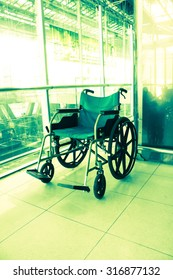 Wheelchair service in airport terminal, vintage color style