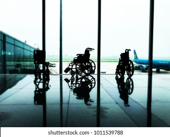 Wheelchair service for disabled passenger at Airport terminal. Travelling concept. Selective focus, blur background.