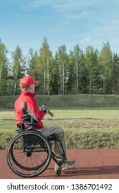 wheelchair shoots skeet on a trench stand with a shotgun