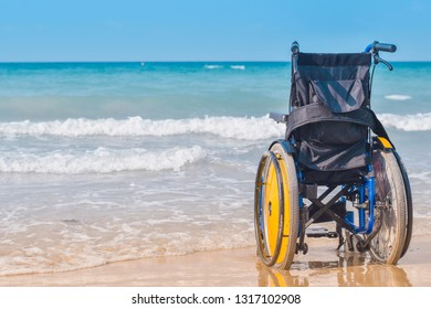 The wheelchair of special child on the  beach, Thailand sea is beautiful and fine white sand.