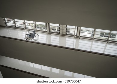 Wheelchair standing in an empty hospital corridor