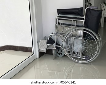 A wheelchair that folds on the wall