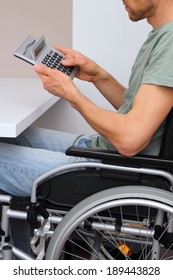 A Wheelchair user with calculator