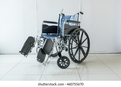 A wheelchair with white wall.