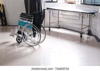 wheelchairs to disabled people in a room with parquet floor