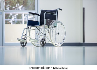 Wheelchairs in the hospital,patient is sitting in a wheelchair,He holds his hands on the wheel,Self-care patients with mobility.