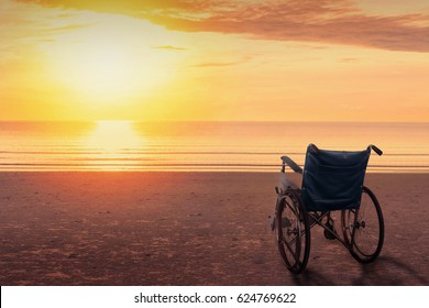 Wheelchairs parked on the beach at sunset time, in a lonely atmosphere.