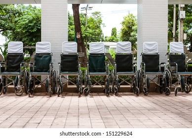 Wheelchairs parked outside a hospital