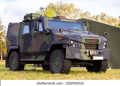 Wheeled armoured vehicle from german army stands on a field