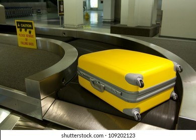 Wheeled luggage on airport conveyor belt