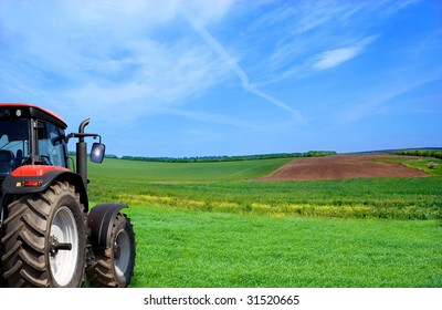 wheeled tractor on a green grass