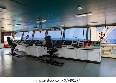 wheelhouse control board of modern industry ship approaching to harbor