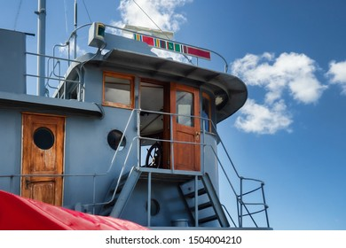 Wheelhouse of a vintage tugboat docked on Lake Ontario in Oswego , New York