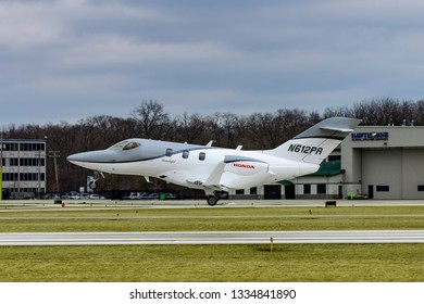 Wheeling, Illinois, United States - March 10, 2019: Honda Jet HA-420 small business jet landing at the Chicago Executive Airport in Wheeling, IL.