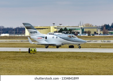 Wheeling, Illinois, United States - March 10, 2019: Honda Jet HA-420 small business jet taxiing after landing.