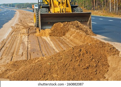 wheelloader working with sand