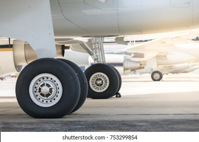 Wheels of airplane at airport for landing.