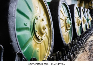wheels in the caterpillar row of military equipment camouflage color, the chassis of the tank