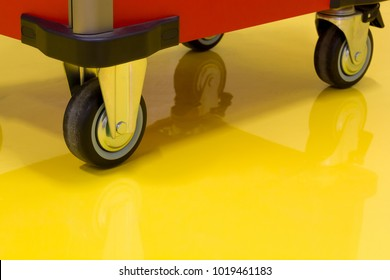 Wheels of Drawer roller tool cabinet on the yellow epoxy floor