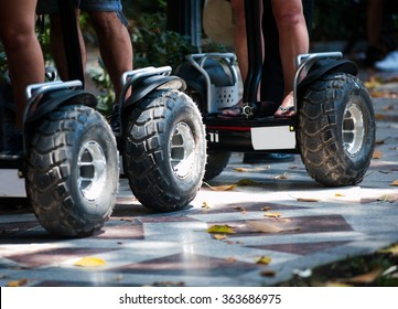 Wheels of electric scooters in the park close up
