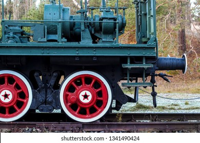 Wheels with a five-pointed star close up Armored artillery train. Fort Red Hill, Krasnaya Gorka. Soviet military transport. Maritime railway artillery. Soviet weapons