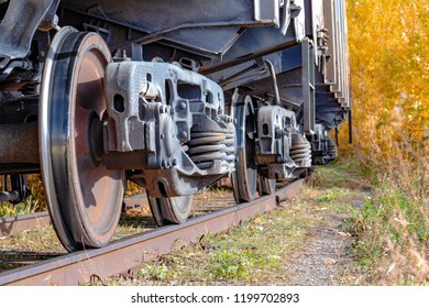 Wheels of freight cars. The concept of logistics by rail. Delivery of cargo by rail.