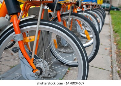 wheels of many bicycles in the city