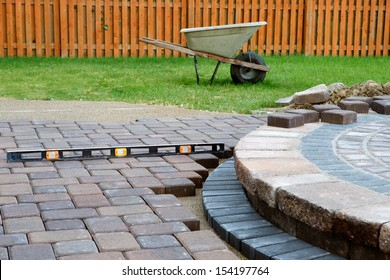 When building a patio prepare to use level and barrel constantly, patio island have polymeric sand laid and job completion almost done when final pavers cut and placed