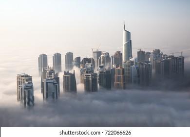 When cold desert air meets warm ocean air, Dubai witnesses a unique phenomenon that sees even the tallest skyscrapers drowning in fog. Dubai, UAE.