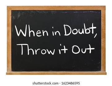 When in doubt, throw it out written in white chalk on a black chalkboard isolated on white
