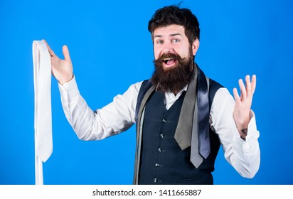 When dressing in suit necktie often add dash of flavor to overall outfit. Man bearded hipster hold few neckties. Guy with beard choosing necktie. Perfect white silk necktie. How to select tie.