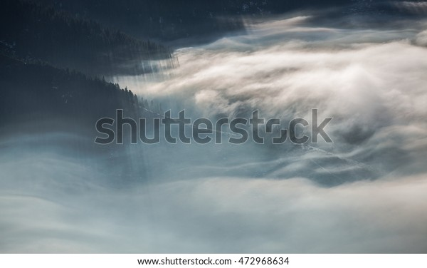 When the mountains in the morning breath. Morning mist in the mountains National Park - Slovak Republic. Early rays of the sun shining through the mountain haze.