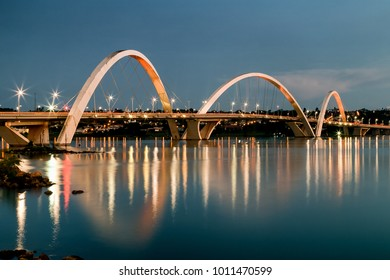 When the night comes the lights appear to illuminate the city. Night view of JK bridge. Sky of Brasilia, capital of Brazil.