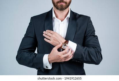 When practical watchmaking becomes pure artistry. Male watch worn with formal suit. Wristlet watch. Portable timepiece. Time management. Professional punctuality. Business etiquette. Modern classic
